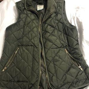 Green puffer vest.